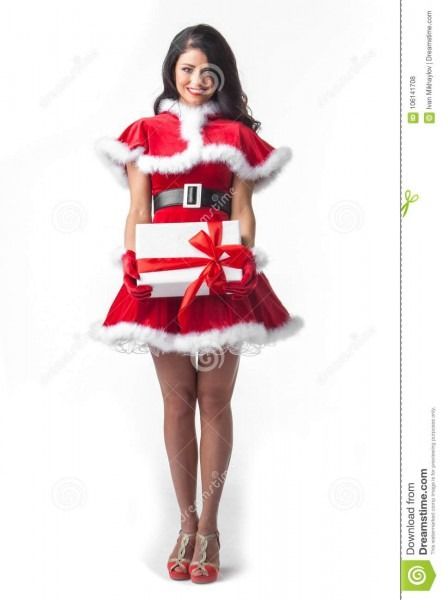 Woman In Santa Dress With Gift Stock Photo