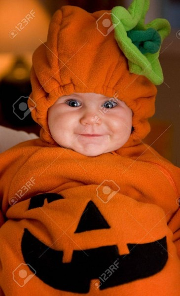 Baby Girl In Halloween Pumpkin Outfit Stock Photo, Picture And