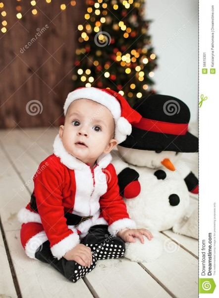 Baby In Santa Suit On The Floor Near Xmas Tree Stock Image