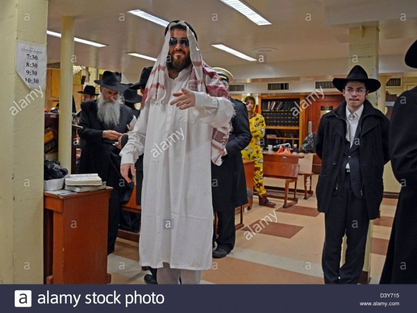 Hasidic Jewish Men In Costume For The Purim Holiday In The Crown